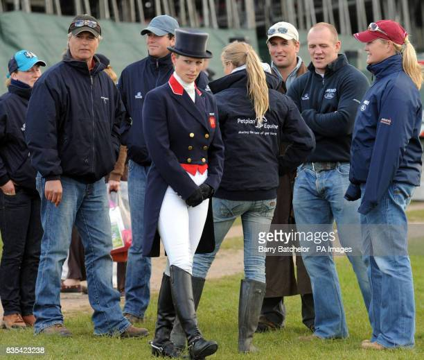 Zara Phillips in front of a group that includes her brother Peter and her boyfreind Mike Tindall after she had completed the dressage on her horse...
