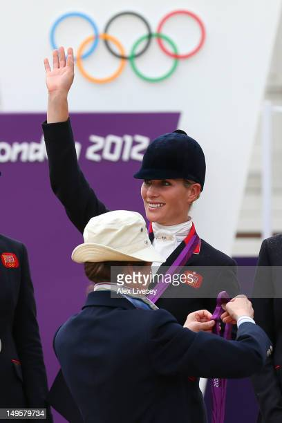 Zara Phillips is presented a silver medal by her mother Princess Anne Princess Royal after the Eventing Team Jumping Final Equestrian event on Day 4...