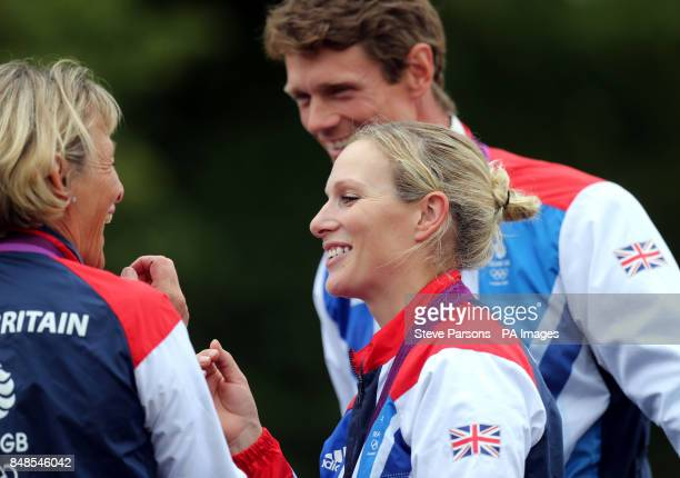 Zara Phillips joins three other members of the Olympic silver medal team on a lap of honor during the Burghley Horse Trials at Burghley Park Stamford