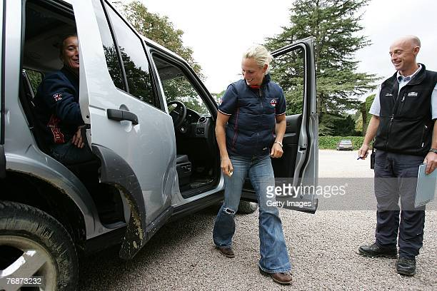 Zara Phillips looks back at the dent on the car after they return from a task during the Land Rover British Eventing OffRoading Day at Eastnor Castle...