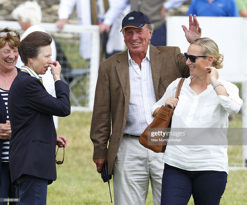 <a gi-track='captionPersonalityLinkClicked' href=/galleries/search?phrase=Zara+Phillips&family=editorial&specificpeople=161323 ng-click='$event.stopPropagation()'>Zara Phillips</a> looks on as her mother <a gi-track='captionPersonalityLinkClicked' href=/galleries/search?phrase=Princess+Anne+-+Princess+Royal&family=editorial&specificpeople=11706204 ng-click='$event.stopPropagation()'>Princess Anne</a>, The Princess Royal and father <a gi-track='captionPersonalityLinkClicked' href=/galleries/search?phrase=Mark+Phillips+-+Equestrian&family=editorial&specificpeople=159684 ng-click='$event.stopPropagation()'>Mark Phillips</a> share a joke during day 1 of the Festival of British Eventing at Gatcombe Park on August 1, 2014 in Minchinhampton, England.