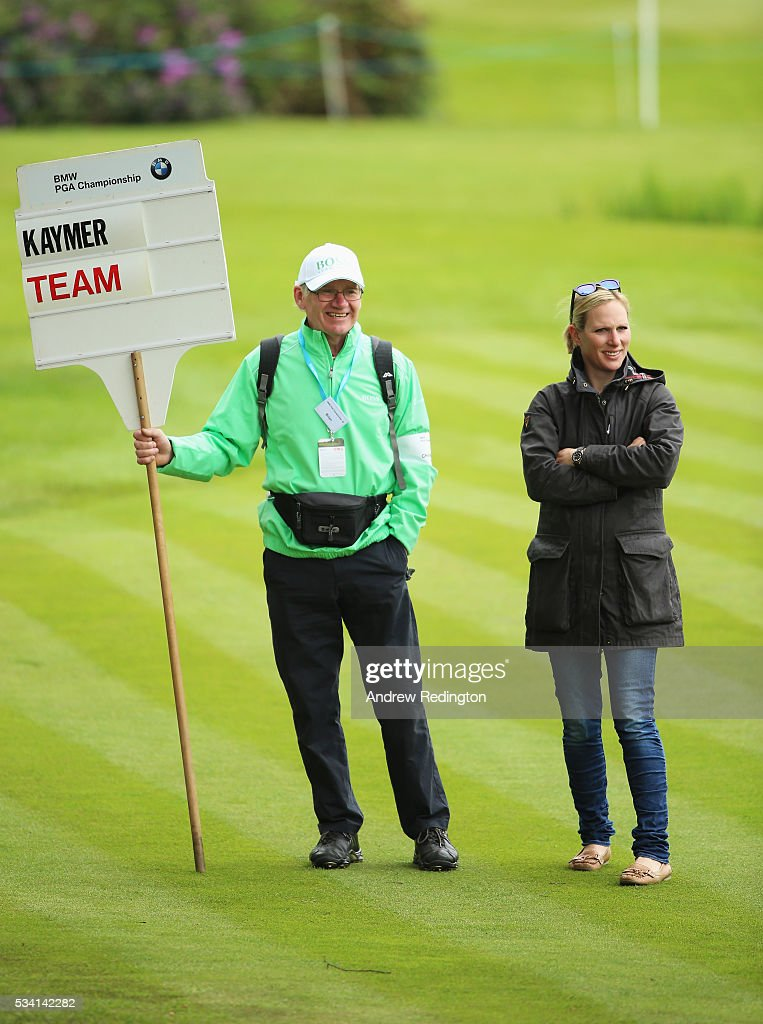 <a gi-track='captionPersonalityLinkClicked' href=/galleries/search?phrase=Zara+Phillips&family=editorial&specificpeople=161323 ng-click='$event.stopPropagation()'>Zara Phillips</a> looks on with a scorer during the Pro-Am prior to the BMW PGA Championship at Wentworth on May 25, 2016 in Virginia Water, England.