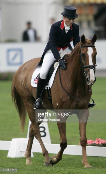 Zara Phillips of Great Britain pats Toy Town after a good performance during the World Individual Team Eventing Championships in the Dressage...