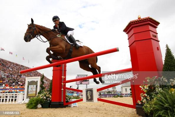 Zara Phillips of Great Britain riding High Kingdom knocks a rail in the Show Jumping Equestrian event on Day 4 of the London 2012 Olympic Games at...
