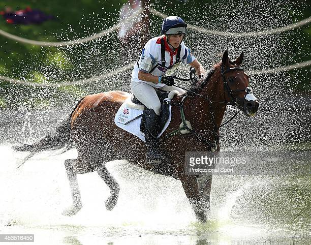 Zara Phillips of Great Britain riding High Kingdom negotiates the water jump in the Eventing Cross Country Equestrian event on Day 3 of the London...