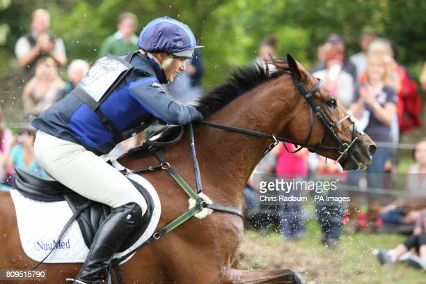 Zara Phillips on board High Kingdom as they pass through the Trout Hatchery during the Cross Country Event during The Land Rover Burghley Horse...