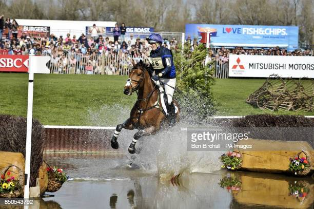 Zara Phillips on High Kingdom hits the flag on the first of two brush jumps and causes a splash in the Lake while taking part in the CrossCountry...