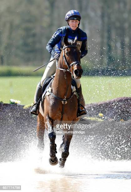 Zara Phillips rides her horse 'Rum Expectations' in the cross country phase of the Gatcombe Horse Trials at Gatcombe Park on March 25 2017 in Stroud...