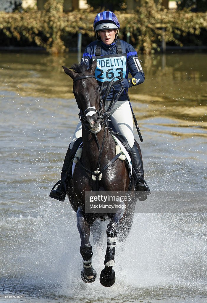 Zara Phillips rides, on her horse Black Tuxedo, through the water obstacle as she competes in the cross country phase of the Blenheim Palace International Horse Trials at Blenheim Palace on September 9, 2012 in Woodstock, England.