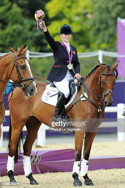Zara Phillips riding High Kingdom waves to the crowd after receiving a silver medal after the Eventing Team Jumping Final Equestrian event on Day 4...