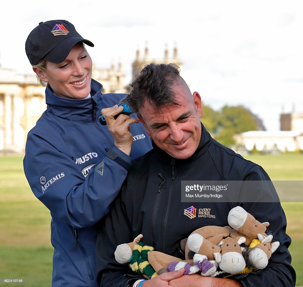 Zara Phillips shaves fellow event rider & commentator Spencer Sturmey's hair in aid of the charity Willberry Wonder Pony (a charity set up in memory of Hannah Francis an 18 year old event rider who died of bone cancer earlier this year) at the Blenheim Horse Trials on September 11, 2016 in Woodstock, England.