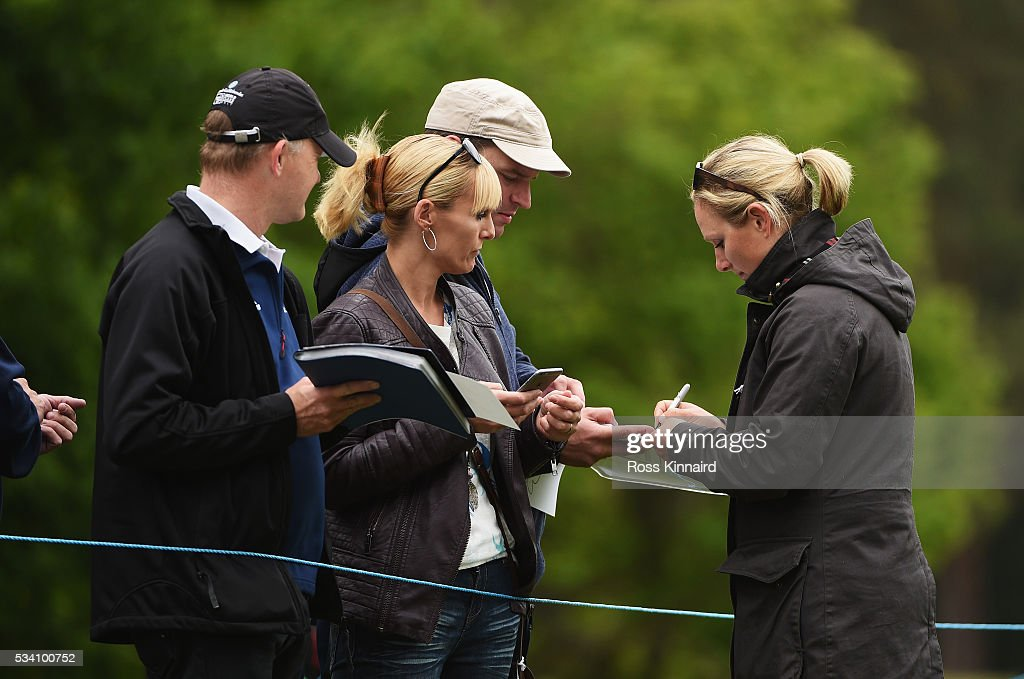 <a gi-track='captionPersonalityLinkClicked' href=/galleries/search?phrase=Zara+Phillips&family=editorial&specificpeople=161323 ng-click='$event.stopPropagation()'>Zara Phillips</a> signs an autograph during the Pro-Am prior to the BMW PGA Championship at Wentworth on May 25, 2016 in Virginia Water, England.