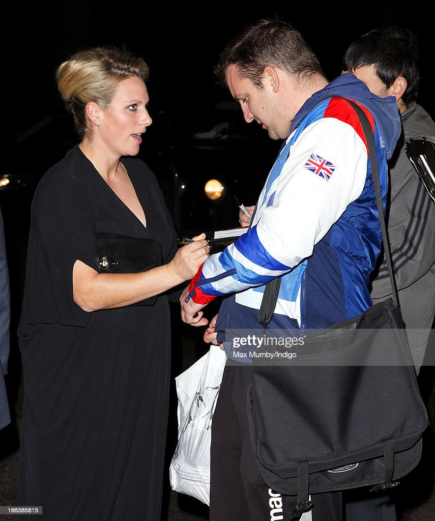 Zara Phillips signs autographs as she attends the British Olympic Ball at The Dorchester on October 30, 2013 in London, England.