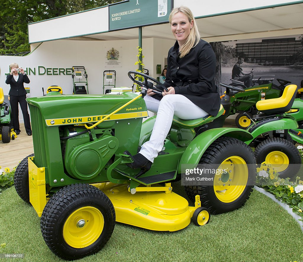 <a gi-track='captionPersonalityLinkClicked' href=/galleries/search?phrase=Zara+Phillips&family=editorial&specificpeople=161323 ng-click='$event.stopPropagation()'>Zara Phillips</a> sits on a tractor mower on the John Deere stand during the Chelsea Flower Show press and VIP preview day at Royal Hospital Chelsea on May 20, 2013 in London, England.