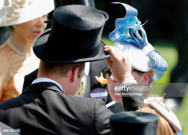 Zara Phillips sticks out her tongue at her cousin Prince William Duke of Cambridge as they attend day 1 of Royal Ascot at Ascot Racecourse on June 20...