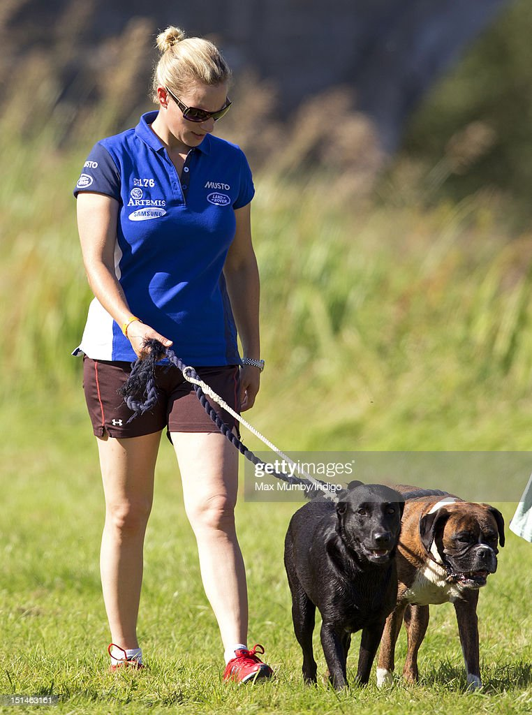 <a gi-track='captionPersonalityLinkClicked' href=/galleries/search?phrase=Zara+Phillips&family=editorial&specificpeople=161323 ng-click='$event.stopPropagation()'>Zara Phillips</a> walks her dogs around the cross country course of the Blenheim Palace International Horse Trials at Blenheim Palace on September 7, 2012 in Woodstock, England.