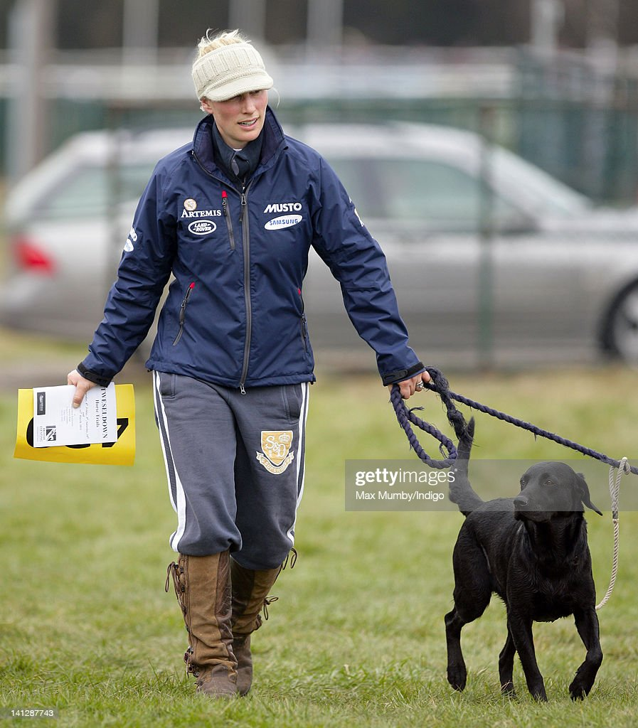 Zara Phillips walks her dogs around the cross country course prior to competing in the Tweseldown Horse Trials at Tweseldown Racecourse on March 9, 2012 in Fleet, England.
