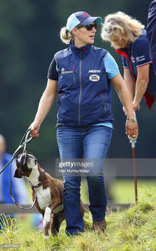 Zara Phillips walks her dogs as she attends the Gatcombe Horse Trials at Gatcombe Park, Minchinhampton on September 22, 2013 in Stroud, England.
