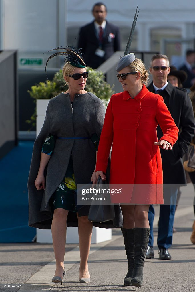 Zara Phillips (R) walks through the racecourse during St Patrick's Day at the Cheltenham Festival at Cheltenham Racecourse on March 17, 2016 in Cheltenham, England. The four day annual jump racing event sees jockeys compete for a piece of the 4.1 million GBP of the prize money.