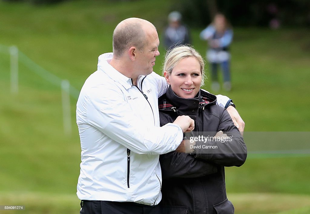 <a gi-track='captionPersonalityLinkClicked' href=/galleries/search?phrase=Zara+Phillips&family=editorial&specificpeople=161323 ng-click='$event.stopPropagation()'>Zara Phillips</a> (R) walks with husband <a gi-track='captionPersonalityLinkClicked' href=/galleries/search?phrase=Mike+Tindall&family=editorial&specificpeople=204210 ng-click='$event.stopPropagation()'>Mike Tindall</a> during the Pro-Am prior to the BMW PGA Championship at Wentworth on May 25, 2016 in Virginia Water, England.