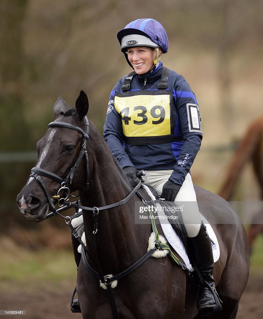 <a gi-track='captionPersonalityLinkClicked' href=/galleries/search?phrase=Zara+Phillips&family=editorial&specificpeople=161323 ng-click='$event.stopPropagation()'>Zara Phillips</a> warms up on her horse 'Black Tuxedo' prior to competing the cross country phase of the Tweseldown Horse Trials at Tweseldown Racecourse on March 9, 2012 in Fleet, England.