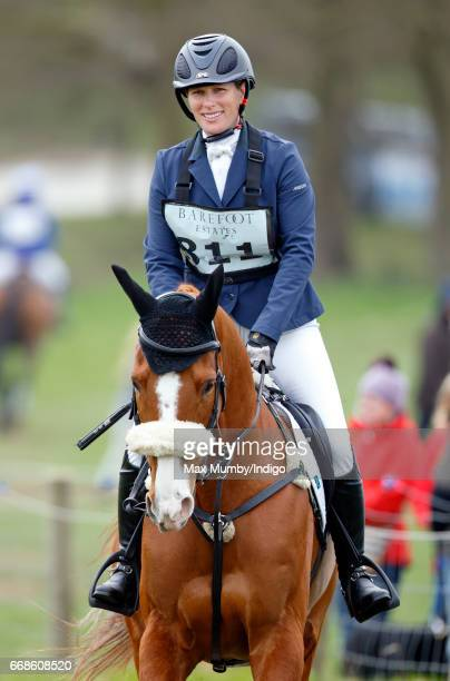 Zara Phillips warms up on her horse 'Fernhill Facetime' before competing in the showjumping phase of the Burnham Market Horse Trials on April 14 2017...