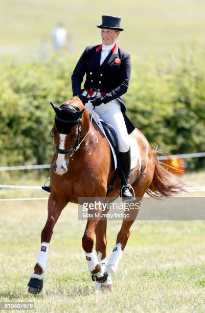 Zara Phillips warms up on her horse 'Fernhill Facetime' before competing in the dressage phase of the Barbury International Horse Trials on July 7...