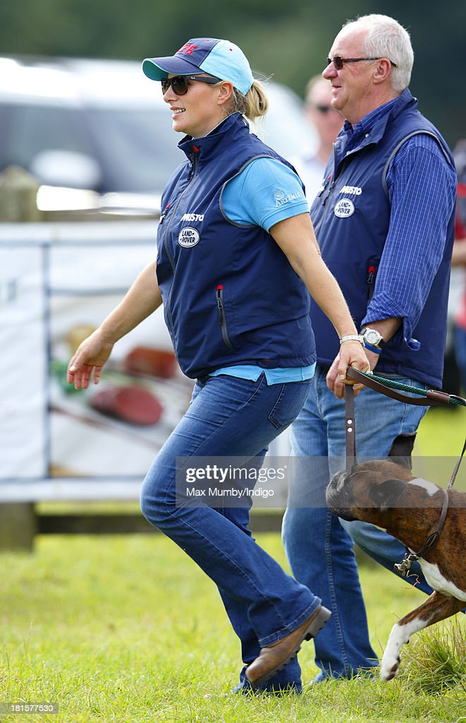 Zara Phillips watches her horse 'Silver Lining V' being ridden in the cross country phase of the Gatcombe Horse Trials at Gatcombe Park, Minchinhampton on September 22, 2013 in Stroud, England.