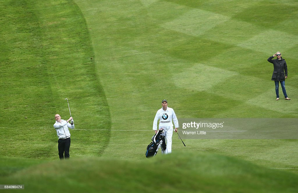 Zara Phillips (R) watches husband Mike Tindall during the Pro-Am prior to the BMW PGA Championship at Wentworth on May 25, 2016 in Virginia Water, England.
