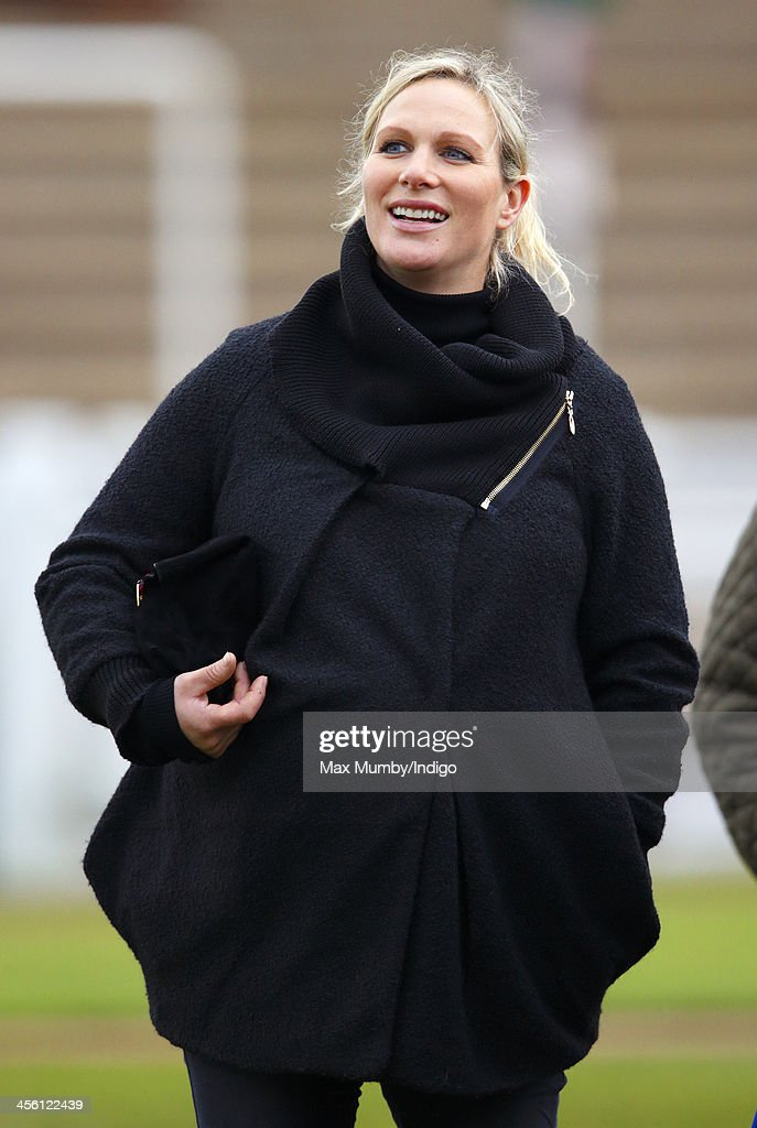 Zara Phillips watches Monbeg Dude (owned by her husband Mike Tindall) run in the Majordomo Hospitality Handicap Steeple Chase at Cheltenham Racecourse on December 13, 2013 in Cheltenham, England.