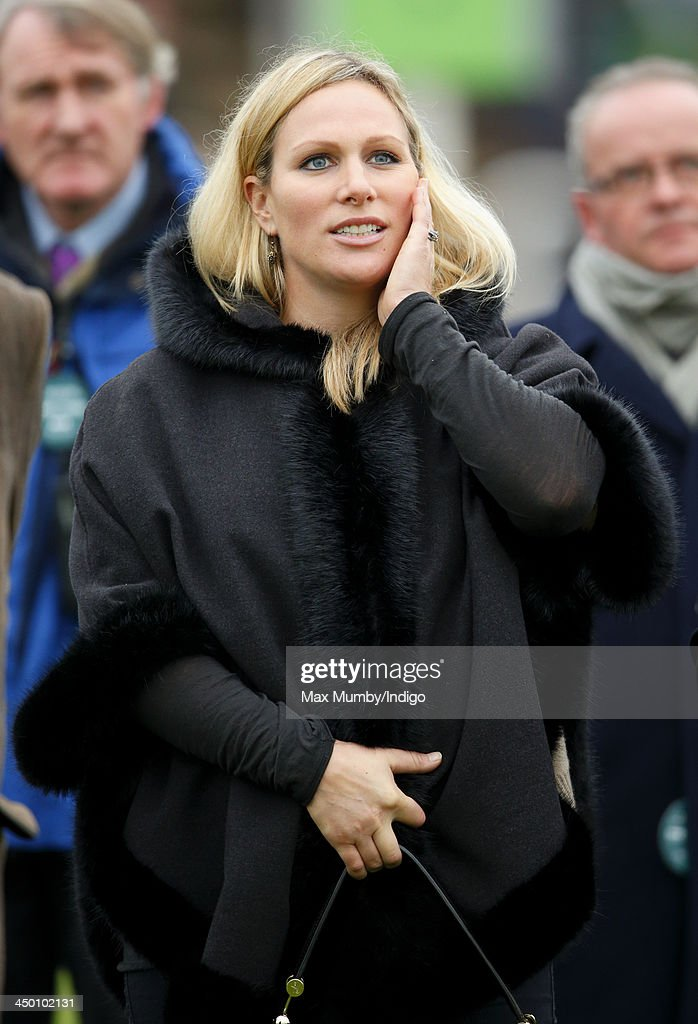 Zara Phillips watches Monbeg Dude (owned by her husband Mike Tindall) run in the Murphy Group Handicap Steeple Chase at Cheltenham Racecourse on November 16, 2013 in Cheltenham, England.