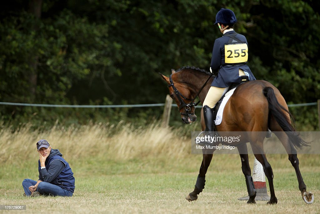 Zara Phillips watches rider Aimee Aspinall compete, on one of Zara's horses, at the Smiths Lawn Horse Trials on August 5, 2013 in Windsor, England.