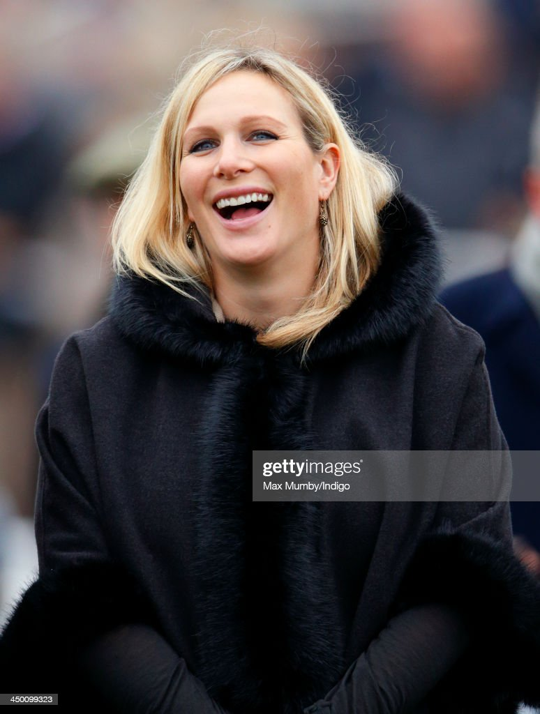 <a gi-track='captionPersonalityLinkClicked' href=/galleries/search?phrase=Zara+Phillips&family=editorial&specificpeople=161323 ng-click='$event.stopPropagation()'>Zara Phillips</a> watches the Paddy Power Gold Cup Steeple Chase at Cheltenham Racecourse on November 16, 2013 in Cheltenham, England.