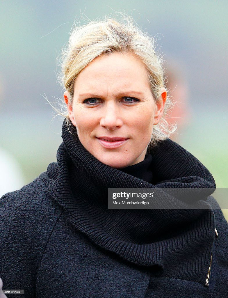 Zara Phillips watches the racing as she and husband Mike Tindall attend The International meeting at Cheltenham Racecourse on December 13, 2013 in Cheltenham, England.