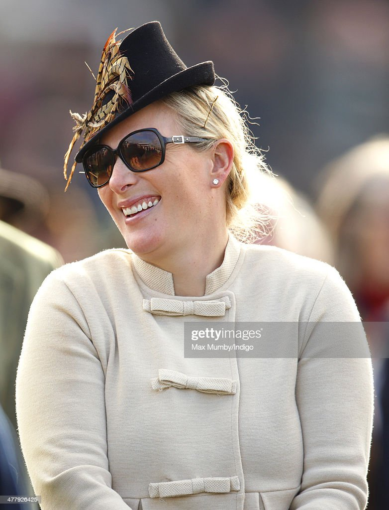 <a gi-track='captionPersonalityLinkClicked' href=/galleries/search?phrase=Zara+Phillips&family=editorial&specificpeople=161323 ng-click='$event.stopPropagation()'>Zara Phillips</a> watches the racing as she attends Day 1 of the Cheltenham Festival at Cheltenham Racecourse on March 11, 2014 in Cheltenham, England.