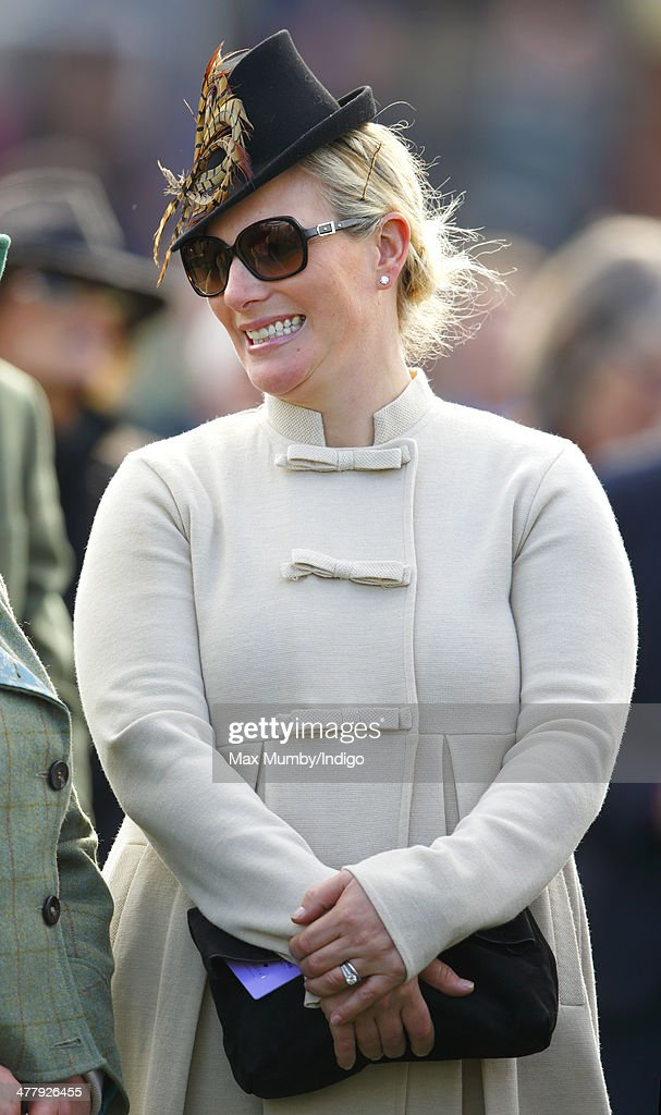 Zara Phillips watches the racing as she attends Day 1 of the Cheltenham Festival at Cheltenham Racecourse on March 11, 2014 in Cheltenham, England.