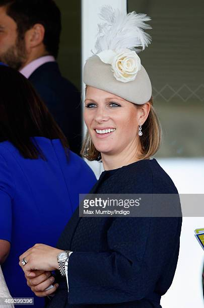 Zara Phillips watches the racing as she attends day 3 'Grand National Day' of the Crabbie's Grand National Festival at Aintree Racecourse on April 11...