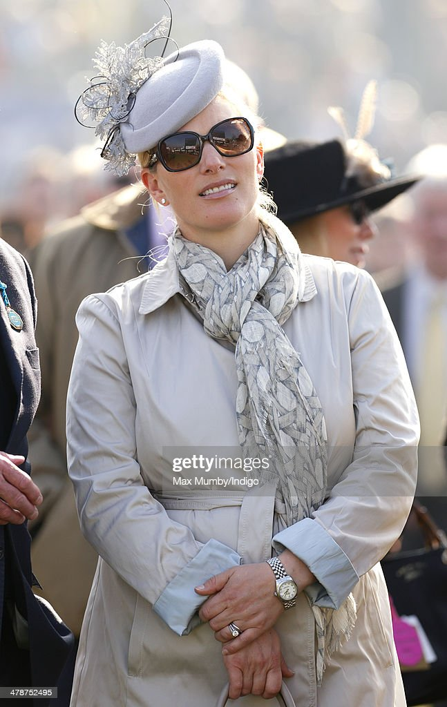 Zara Phillips watches the racing as she attends Day 4 of the Cheltenham Festival at Cheltenham Racecourse on March 14, 2014 in Cheltenham, England.