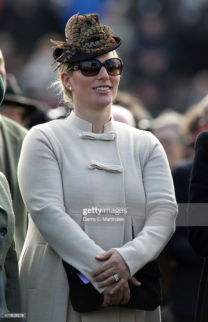 <a gi-track='captionPersonalityLinkClicked' href=/galleries/search?phrase=Zara+Phillips&family=editorial&specificpeople=161323 ng-click='$event.stopPropagation()'>Zara Phillips</a> watches the third race on day 1 of The Cheltenham Festical at Cheltenham Racecourse on March 11, 2014 in Cheltenham, England.