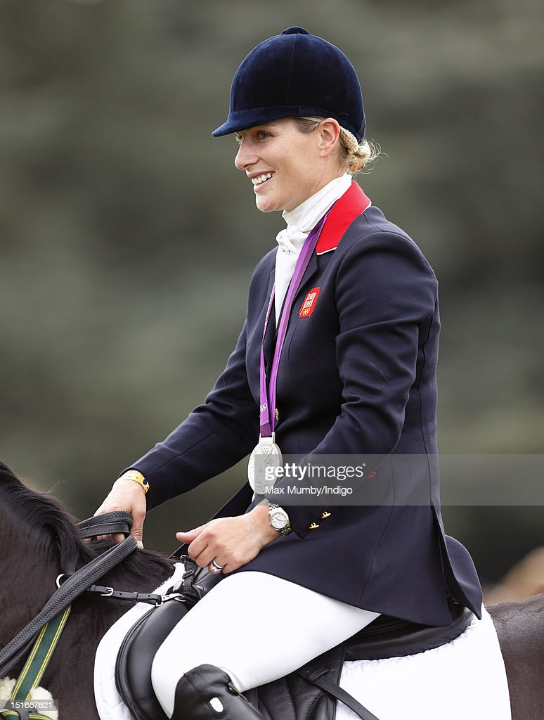 <a gi-track='captionPersonalityLinkClicked' href=/galleries/search?phrase=Zara+Phillips&family=editorial&specificpeople=161323 ng-click='$event.stopPropagation()'>Zara Phillips</a> wears her London 2012 Olympic silver medal as she and her fellow team eventing medal winners parade at the Blenheim Palace International Horse Trials on September 9, 2012 in Woodstock, England.