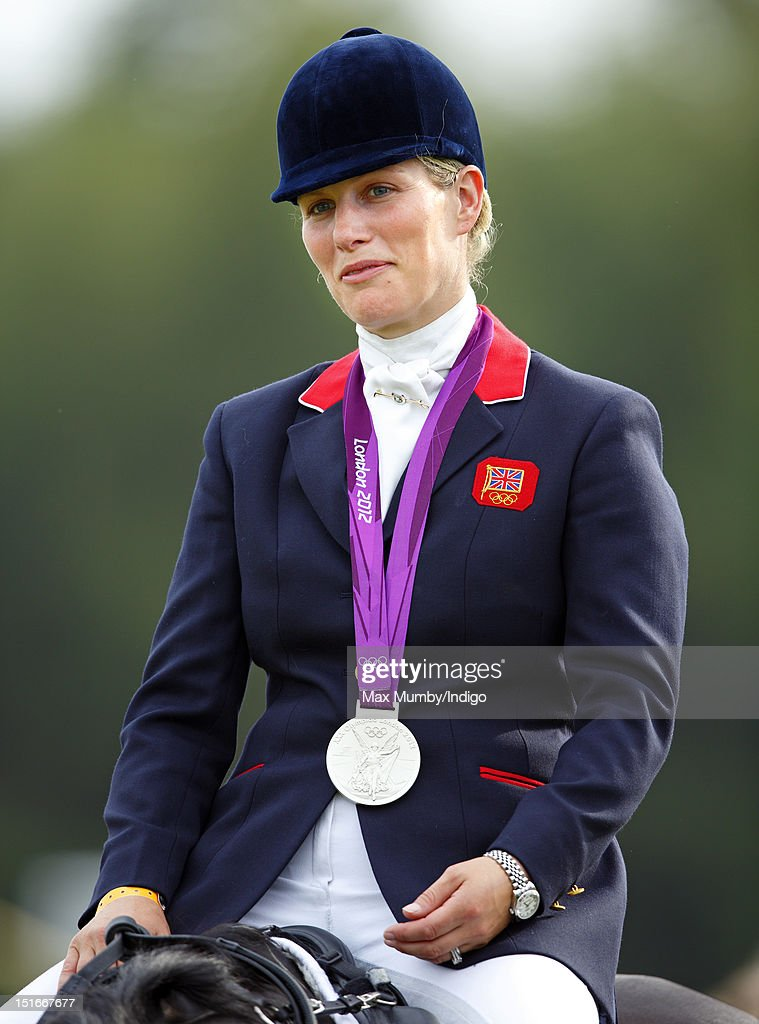 Zara Phillips wears her London 2012 Olympic silver medal as she and her fellow team eventing medal winners parade at the Blenheim Palace International Horse Trials on September 9, 2012 in Woodstock, England.