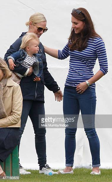 Zara Phillips with daughter Mia Tindall greets Catherine Duchess of Cambridge as they attend the Gigaset Charity Polo Match at the Beaufort Polo Club...