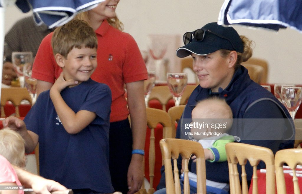 Zara Phillips, with daughter Mia Tindall, jokes with her cousin James, Viscount Severn (son of Prince Edward, Earl of Wessex & Sophie, Countess of Wessex) as she attends day 2 of the Festival of British Eventing at Gatcombe Park on August 2, 2014 in Minchinhampton, England.