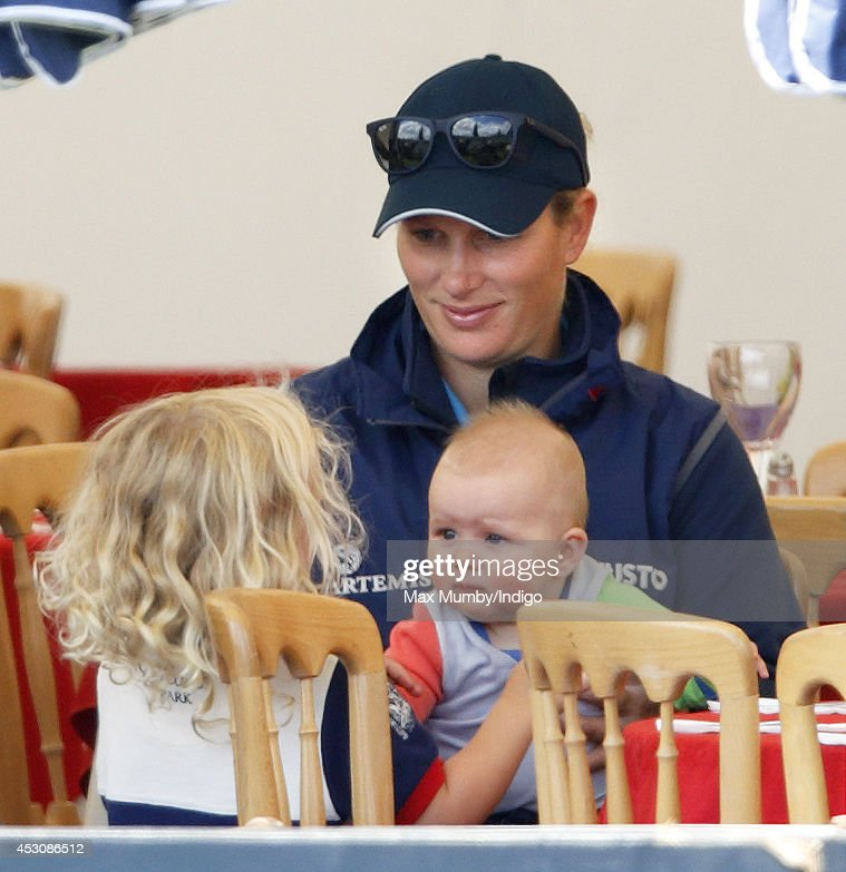 <a gi-track='captionPersonalityLinkClicked' href=/galleries/search?phrase=Zara+Phillips&family=editorial&specificpeople=161323 ng-click='$event.stopPropagation()'>Zara Phillips</a>, with daughter <a gi-track='captionPersonalityLinkClicked' href=/galleries/search?phrase=Mia+Tindall&family=editorial&specificpeople=12480820 ng-click='$event.stopPropagation()'>Mia Tindall</a>, talks with her niece <a gi-track='captionPersonalityLinkClicked' href=/galleries/search?phrase=Savannah+Phillips&family=editorial&specificpeople=7594205 ng-click='$event.stopPropagation()'>Savannah Phillips</a> as she attends day 2 of the Festival of British Eventing at Gatcombe Park on August 2, 2014 in Minchinhampton, England.