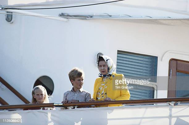 Zara Phillips with her brother Peter Philips and their grandmother Queen Elizabeth II on board the Royal yacht Britannia at the start of a Western...