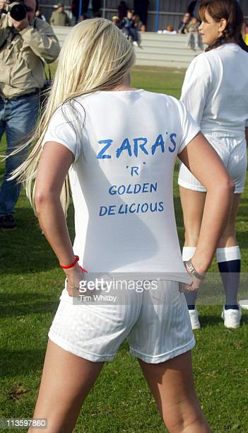 Zara Powell from the Page 3 Girls Team displays her cheeky tshirt at a celebrity football match today at Walham Forest FC in Walthamstow East London...