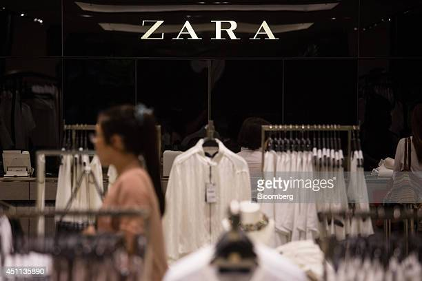 Zara signage is displayed on a wall inside a Zara store operated by Inditex SA in Hong Kong China on Tuesday June 24 2014 Inditex which has increased...