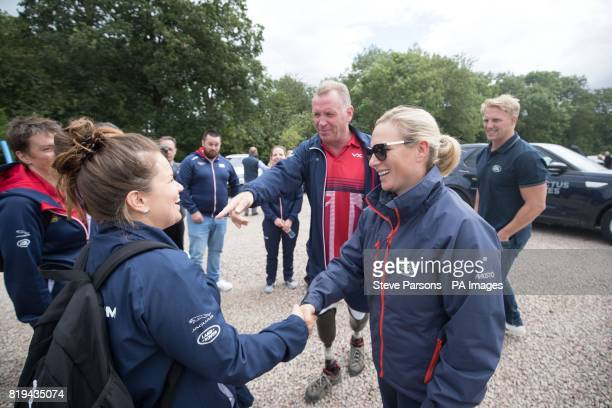 Zara Tindall and Lewis Moody talk to members of the Invictus Games UK team during the Jaguar Land Rover Driving Challenge at the Land Rover...