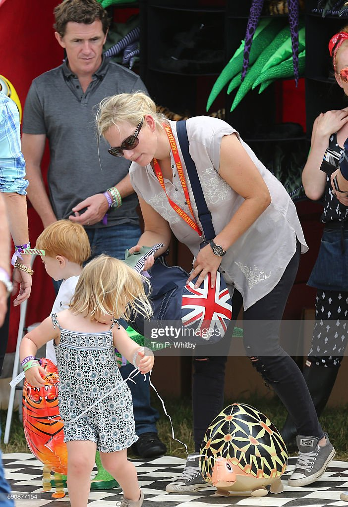 zara-tindall-helps-her-daughter-mia-tindall-with-a-toy-balloon-during-picture-id596877154