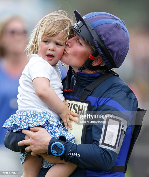 Zara Tindall kisses daughter Mia Tindall after competing in the cross country phase of the Badminton Horse Trials on May 7 2016 in Badminton England